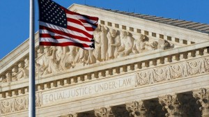 American flag flies in front of the Supreme Court in Washington in this June 27, 2012 file photo. (Alex Brandon/AP Photo)