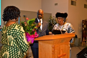 Pastor Brenda Patterson and Pastor Dr. Terrance Woodson present flowers to Sis. Shirley Tarpley at the Black History celebration on Feb. 8, 2015