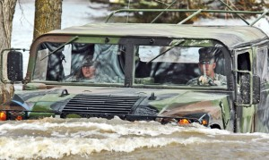 US Army Staff Sgt. William Griffin and Spc. Jessica Sandberg drive a Humvee on a flooded road in Fort Ransom, North Dakota, April 15, 2009. (Credit: US Air Force photo by Senior Master Sgt. David H. Lipp/Released via Expert Infantry/Flickr)