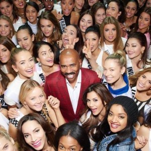 Steve Harvey pictured with Miss Universe 2015 contestants.