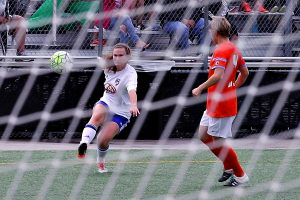 FC Dallas' Kelley Monogue fires a shot on goal past Houston's Rebecca Moros. The shot was thwarted by the goalkeeper as Dallas was held scoreless against the NWSL team in the friendly on June 2. (Photo: David Wilfong)