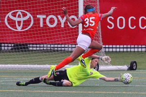 FC Dallas goalkeeper Kelsey Devonshire came off the line to challenge and end this run on goal from Houston Dash forward Bianca Brinson. Brinson, who is on the reserve roster for Houston, also plays for FC Dallas' WPSL team during normal league competition. (Photo: David Wilfong)